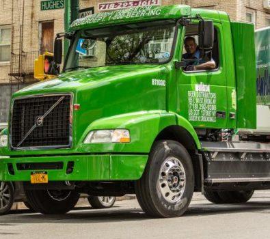 A Man Riding Green Truck